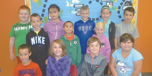 Above are the 6-8-year-old members of the TD Summer Reading Club at the High Prairie Municipal Library. In the front row, left-right, are Chance Willis, Zaida Auger, Jarrett Hicks and Marley Giroux. In the middle row, left-right, are Grayson Fowlie, Zennyn Auger and Hannah Copeland. In the back row, left-right, are Sandy Gairdner-Robinson, Ava Willis, Taylor Copeland, Dylan Hicks, and Kashton Davidson.