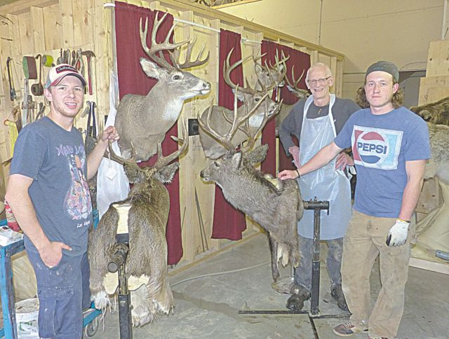 The crew at Dave Booth Taxidermy at the shop in Kinuso (l. to r.) Brody Teale, Dave Booth, Erik Labrie.