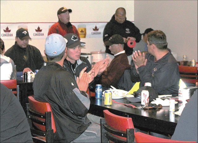 Golfers enjoying supper at the McLennan club house following a long day on the course at the 3-Ball, Best Ball Tournament.