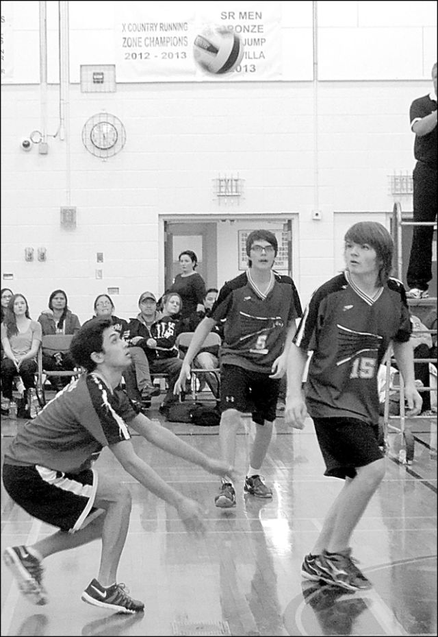 E.W. Pratt Charger Abdullah Sharkawi, left, bumps the ball as teammates Brandon McNabb, centre, and Tanner Stokes look on during the volleyball tournament final against Mistassiny.