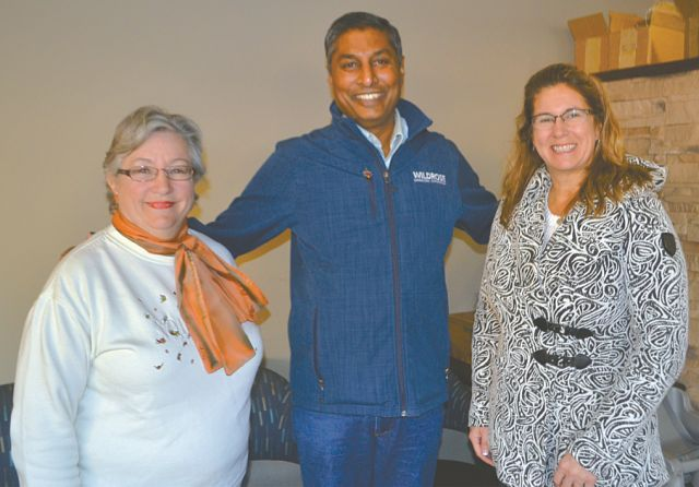 Town of High Prairie Mayor Linda Cox, left, and Councillor Debbie Rose, right, stand with Prasad Panda, shadow minister of economic development and trade with the Official Opposition Wildrose during his visit Oct. 19.