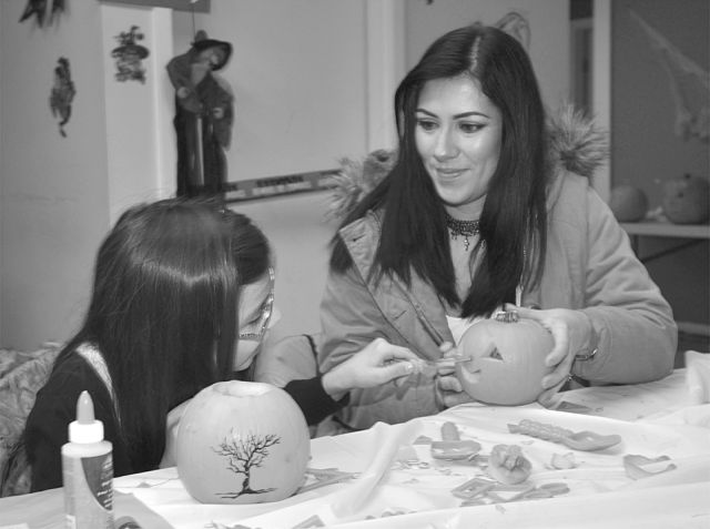 Paula Vergara, right, and her daughter, Violeta Vasquez, 8, enjoyed some family time by carving small pumpkins.