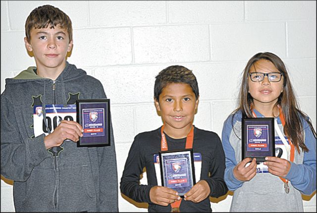 Grade 6 winners included three students because there was a tie in the boy's race. Left-right are East Prairie Hillview School's Robert Grievson, left, Little Buffalo School's Tyler Favel, centre, both in the boy's race, and Little Buffalo School's Trinity Calliou in the girl's race.