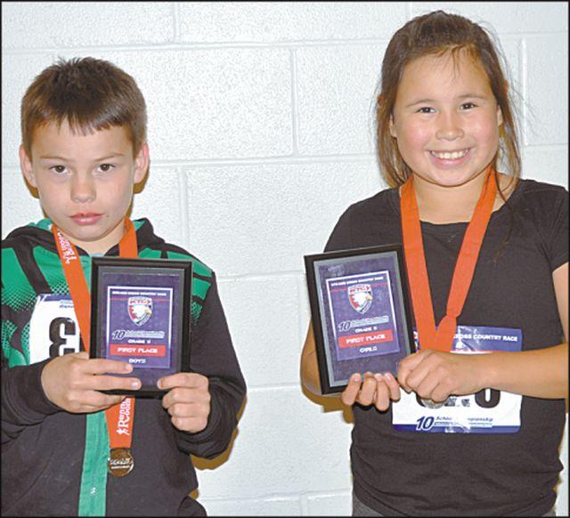Grade 5 race winners included East Prairie Hillview School's Theoren Desjarlais, left, in the boy's race, and Karlie Letendre, of Peerless Lake School in the girl's race.
