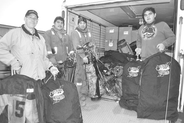 Donated sports equipment is hauled out of a trailer. Left-right are Town of High Prairie Councillor Brian Gilroy and public works staff Jarrod Chalifoux, Jayson Ferguson and Jonathan Chalifoux.