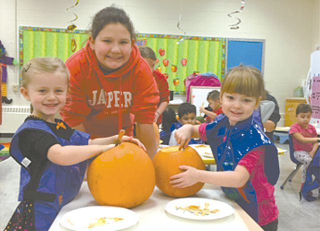 So much fun carving pumpkins! High Prairie Play Program students carved pumpkins Oct. 25. From the lower left and proceeding clockwise are Ethan Gaschnitz, Jonathan Senkoe, Bradly Robinson, Hannah Sharkawi and Aryanna Khan.