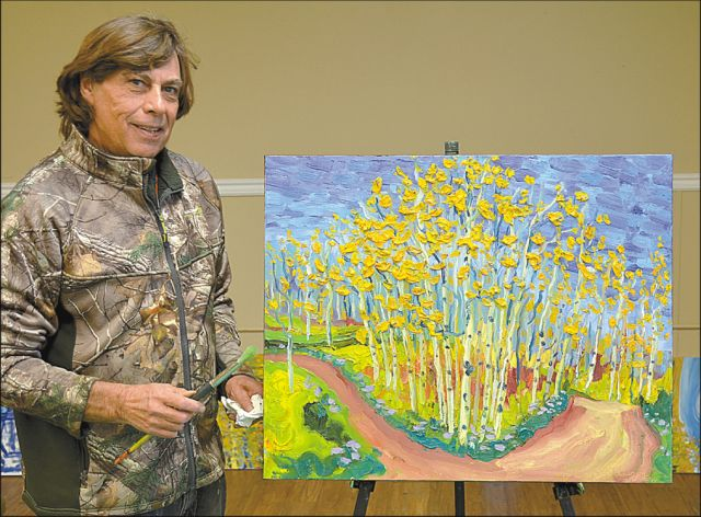 """Pierre """"A.J."""" Sabourin with some of his artworks based on the Watino area. He plans to host an event in Eaglesham in March 2017, where some of his paintings from the Watino area will be sold as limited edition prints. The paintings will be on display at the Watino community hall once they're completed."""