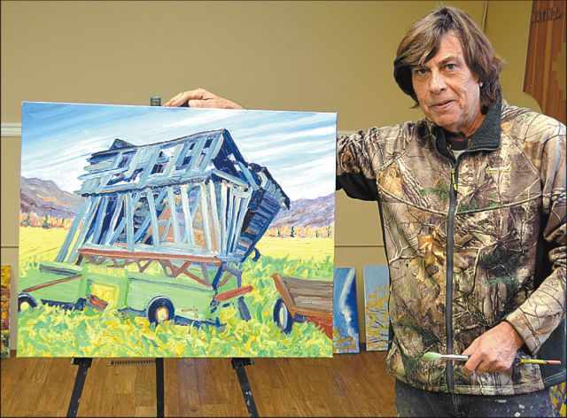"""Pierre """"A.J."""" Sabourin with some of his artworks based on the Watino area."""