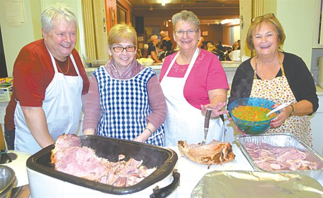 Food was prepared a several cooks in the kitchen. Left-right, are Alfred Urvan, Marilyn Veserry, Lorene Comeau and Sharon Cox.
