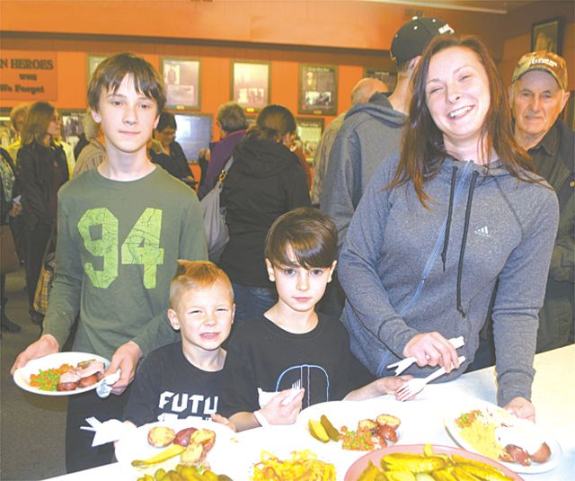 People of all ages and families enjoyed the full-course meal. Left-right, are Trent Douglas, 12, Evan Douglas, 6, and Hayden Douglas, 7, with their mother Leanne Smith.