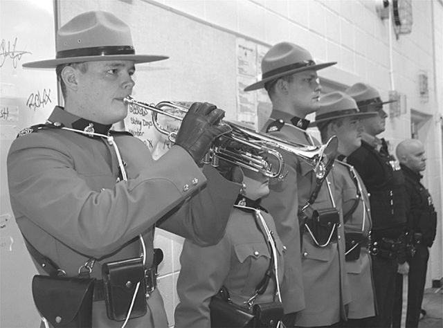 High Prairie RCMP Cst. Ben Brace plays the trumpet for The Last Post.