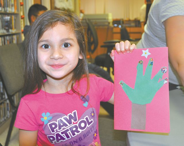 A gift card fit for...! Arianna Palisoc, 4, of High Prairie, was one of many children to make a greeting card. The imprint of a child's hand is on the front and a special message written inside for - well, that's a secret!