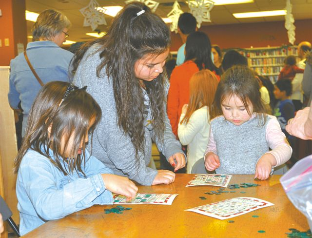 Ever play Christmas bingo? Instead of numbers, they use Christmas decorations Left-right are Emily Belcourt, 6, Carys Belcourt, 13, and Claire Laderoute, 3, all of High Prairie.