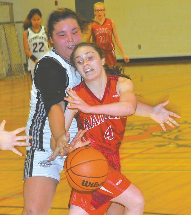 Gift Lake's Tamara Courtorielle, left, reaches for the basketball against Prairie River's Rae Anne Gill during action Nov. 23. PRJH won the game 69-24.