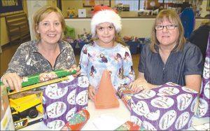 Santa's Little Helpers distribute 19 Christmas hampers