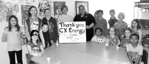 CX Energy Services donates to library