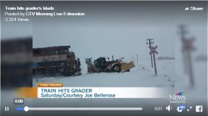 Grader collides with freight train east of town