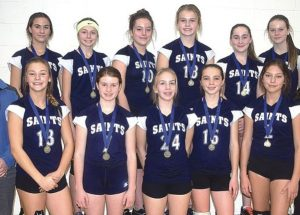 Saints retain junior high volleyball title