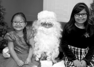 PICs – Kids 'book' in Christmas at library